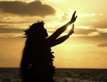 hula dancer at sunset