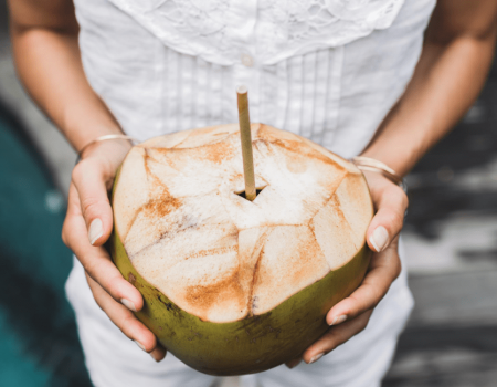 holding green coconut