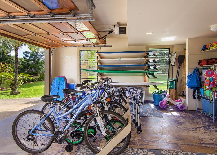 Garage stocked with bikes and water sports gear
