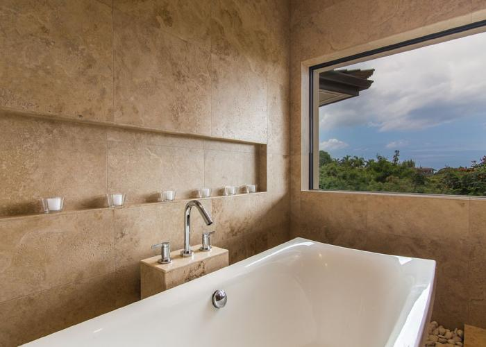 Large soaking bathtub with mountain views