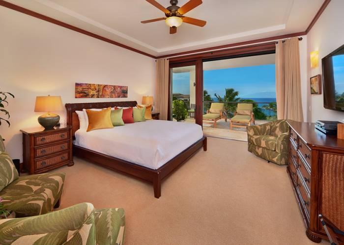 The Oceanview King Size Master Bedroom is Tastefully Decorated with a Pillow Top Mattress, Top-quality Linens, Velvet Lined Drapery, Carpet, Hardwood furnishings, iPod dock, HD Television & HD Cable, HD CD/DVD Player, Walk-in closet, Side Seating, En-suite Private Bath