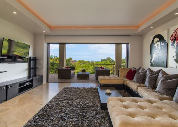 Downstairs living area with open doors to lanai