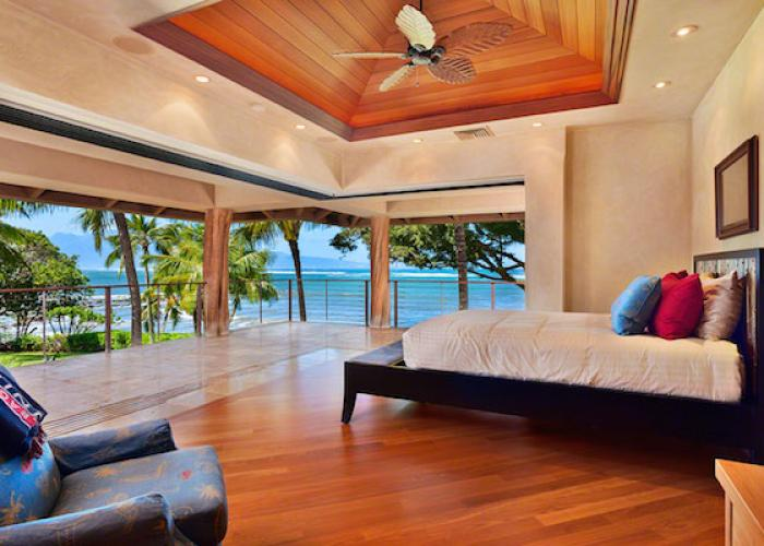 Bedroom with open walls and ocean views