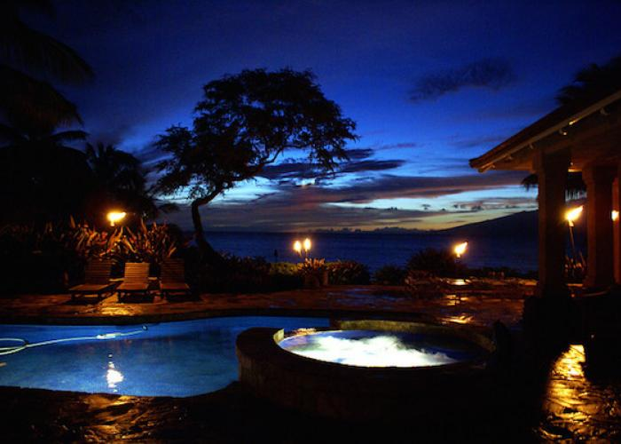 Pool at dusk with tiki torches