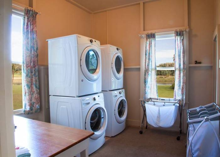 Laundry room with 2 sets of washer/dryer