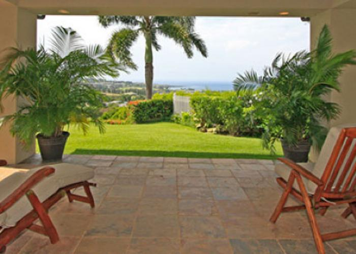 Covered lanai with two chairs