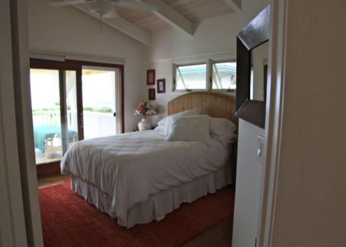 Upstairs queen bedroom with ocean views