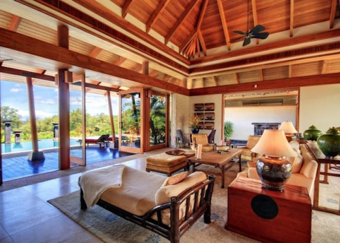 Indoor living room looking out to pool