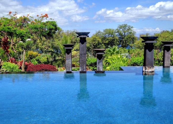 Pool with ocean views beyond