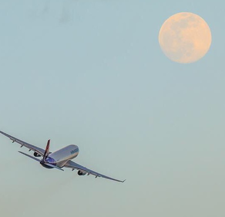Airplane flying into moon