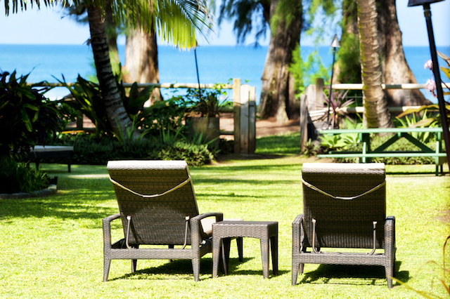 Two chaise lounges in yard looking towards Hanalei Bay