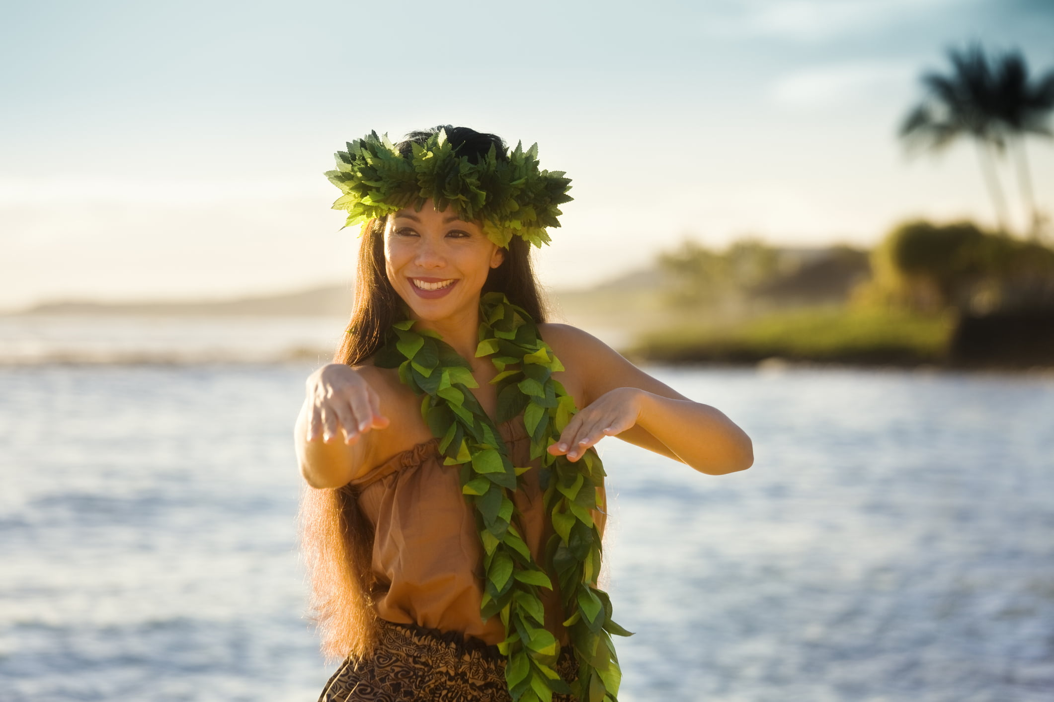 hawaiian dancer with green leaf lei
