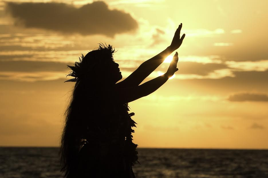 hula dancer at sunset