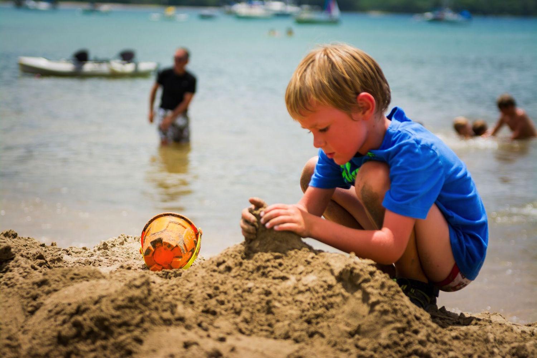 Little boy building castle